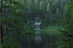 Landschaftsfoto Bergsee mit Hütte